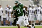 Wide receiver Kyle Brown of the Michigan State Spartans carries the ball against the Northwestern Wildcats at Spartan Stadium on October 22 2005 in...