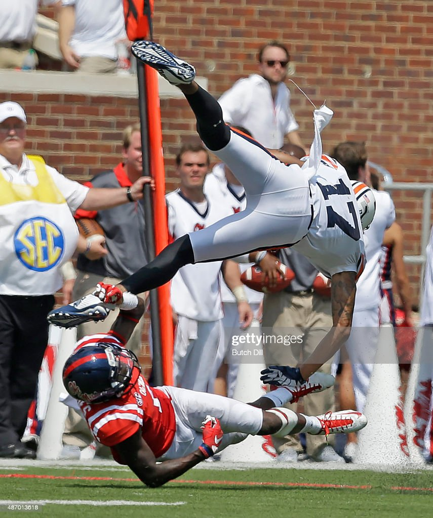 wide receiver Kyle Kerrick #17 of the Tennessee Martin Skyhawks flips after he is tripped up by defensive back Tony Bridges #1 of the Mississippi Rebels during the second quarter of a NCAA college football game at Vaught-Hemingway Stadium on September 5, 2015 in Oxford, Mississippi.