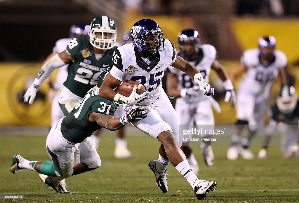 Wide receiver LaDarius Brown #85 of the TCU Horned Frogs runs with football after a reception against the Michigan State Spartans during the Buffalo Wild Wings Bowl at Sun Devil Stadium on December 29, 2012 in Tempe, Arizona. The Spartans defeated the Horned Frogs 17-16.