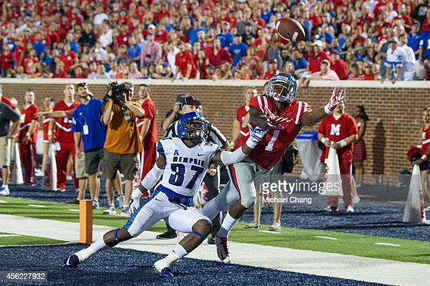 Wide receiver Laquon Treadwell of the Mississippi Rebels attempts to catch a pass in front of defensive back Bakari Hollier of the Memphis Tigers on...