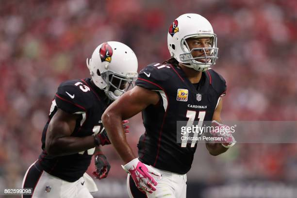 Wide receiver Larry Fitzgerald of the Arizona Cardinals and Jaron Brown step up to the line during the first half of the NFL game against the Tampa...