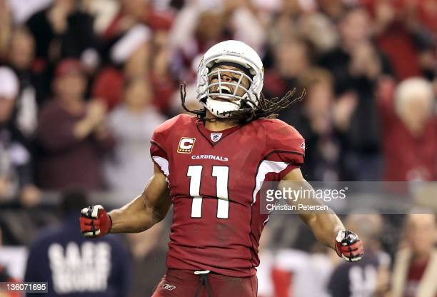 Wide receiver Larry Fitzgerald of the Arizona Cardinals celebrates after a 32 yard reception against the Cleveland Browns during overtime of the NFL...