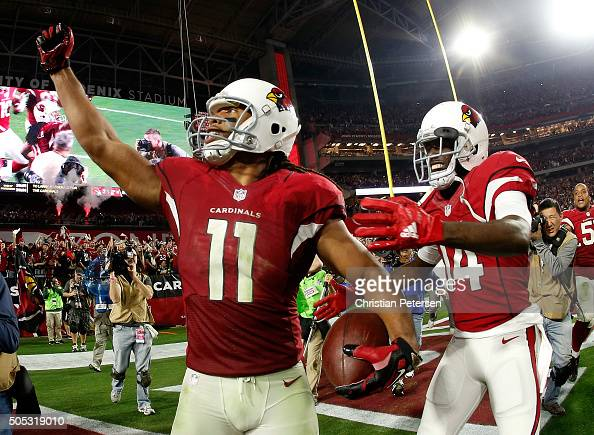 Wide receiver Larry Fitzgerald of the Arizona Cardinals celebrates his game winning touchdown in overtime with wide receiver JJ Nelson during the NFC...
