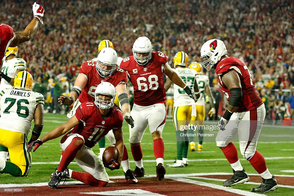 Wide receiver Larry Fitzgerald of the Arizona Cardinals celebrates after scoring the game winning touchdown in overtime to beat the Green Bay Packers...