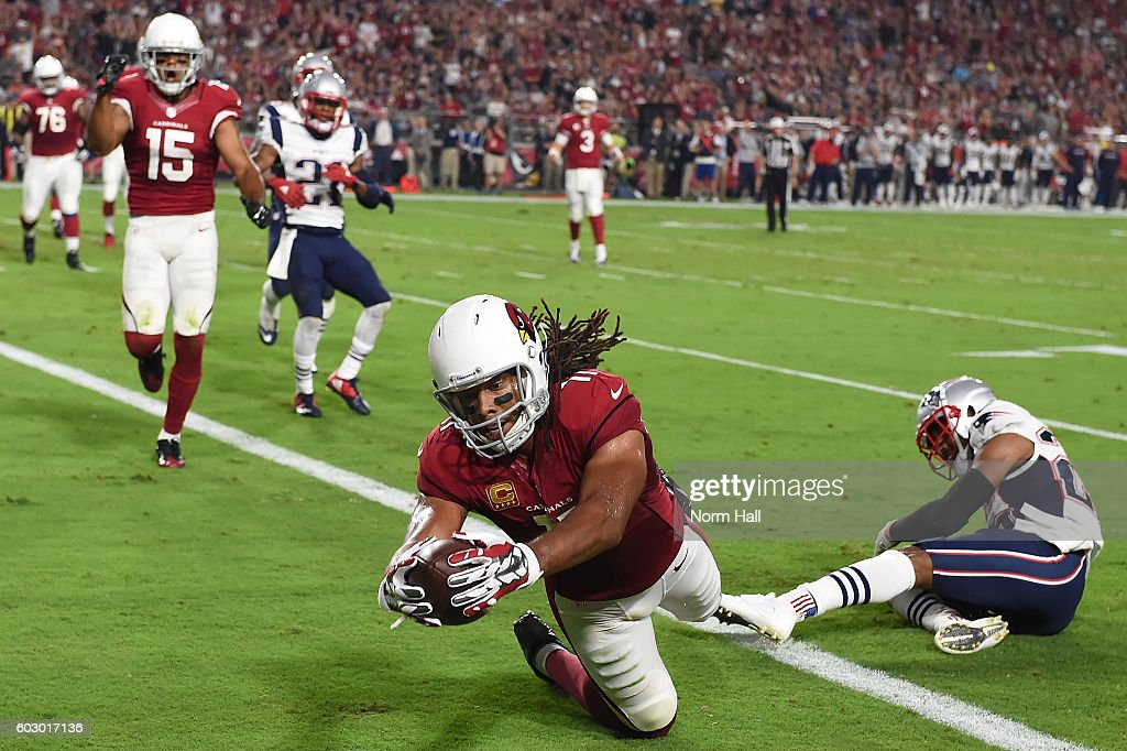 Wide receiver Larry Fitzgerald #11 of the Arizona Cardinals dives in front of cornerback Logan Ryan #26 of the New England Patriots to score a touchdown in the second quarter of the NFL game at University of Phoenix Stadium on September 11, 2016 in Glendale, Arizona.