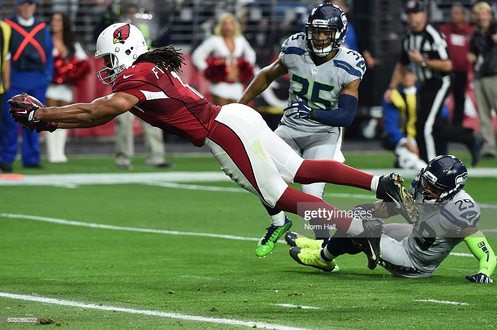 Wide receiver <a gi-track='captionPersonalityLinkClicked' href=/galleries/search?phrase=Larry+Fitzgerald&family=editorial&specificpeople=183380 ng-click='$event.stopPropagation()'>Larry Fitzgerald</a> #11 of the Arizona Cardinals dives into the endzone to score a 17 yard touchdown against the Seattle Seahawks in the second quarter of the NFL game at University of Phoenix Stadium on January 3, 2016 in Glendale, Arizona.
