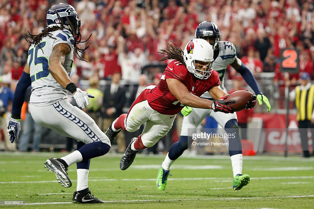 Wide receiver Larry Fitzgerald of the Arizona Cardinals dives into the endzone to score a 17 yard touchdown in the second quarter of the NFL game...