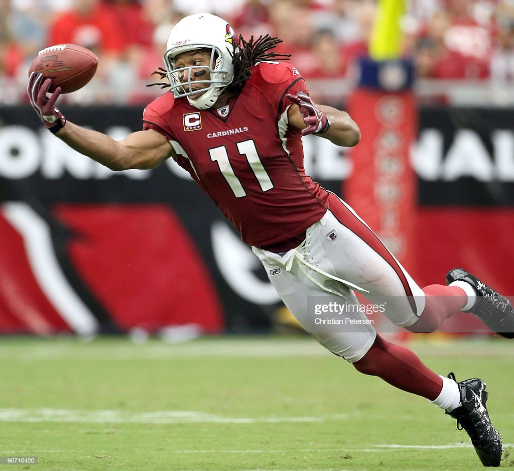 Wide receiver <a gi-track='captionPersonalityLinkClicked' href=/galleries/search?phrase=Larry+Fitzgerald&family=editorial&specificpeople=183380 ng-click='$event.stopPropagation()'>Larry Fitzgerald</a> #11 of the Arizona Cardinals is unable to catch a pass during the NFL game against the San Francisco 49ers at the Universtity of Phoenix Stadium on September 13, 2009 in Glendale, Arizona. The 49ers defeated the Cardinals 20-16.