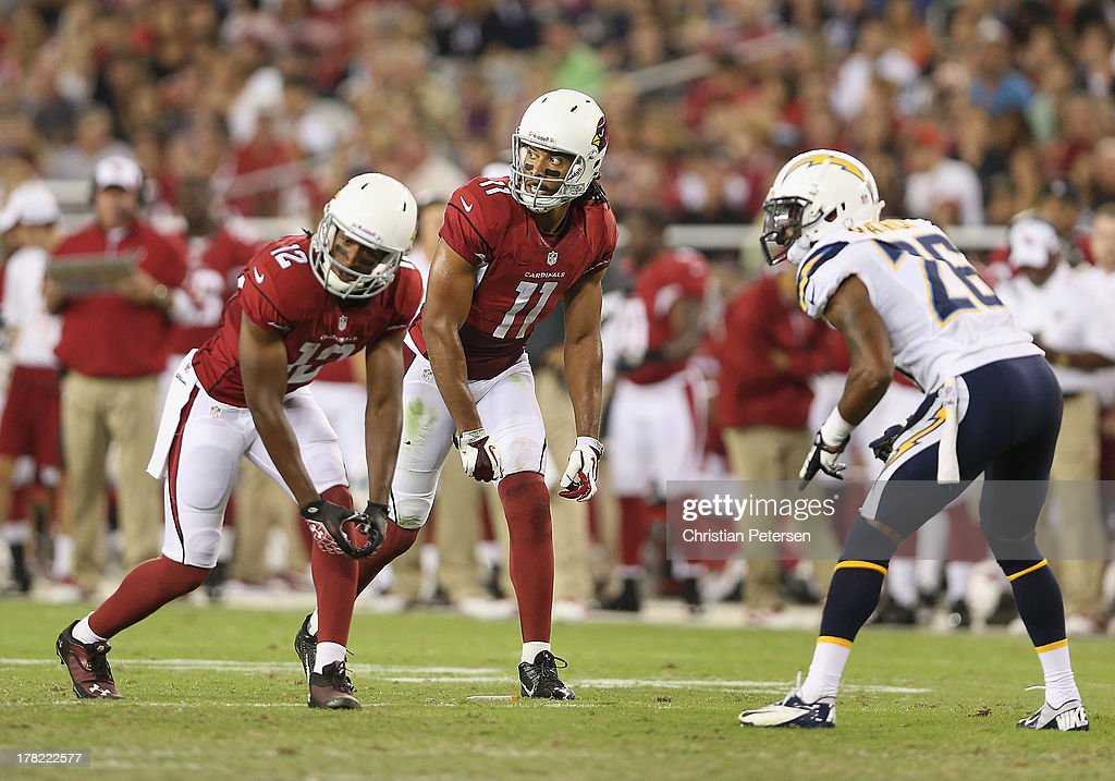 Wide receiver Larry Fitzgerald #11 (C) of the Arizona Cardinals lines up alongside wide receiver Andre Roberts #12 during the preseason NFL game against the San Diego Chargers at the University of Phoenix Stadium on August 24, 2013 in Glendale, Arizona.