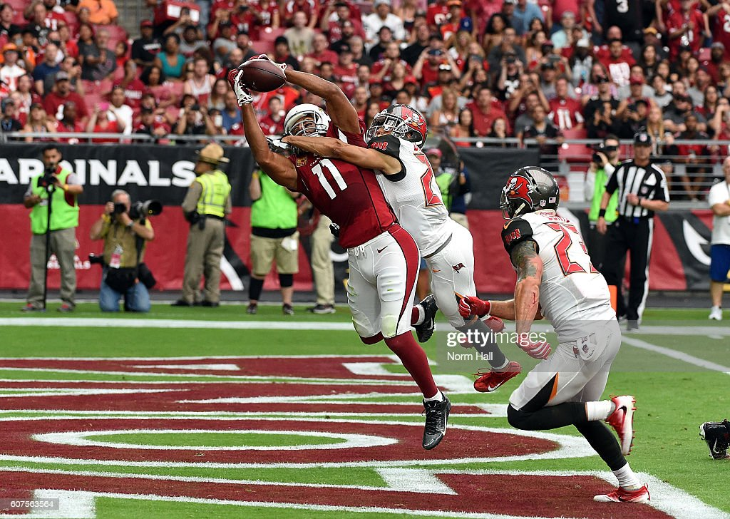 Wide receiver Larry Fitzgerald #11 of the Arizona Cardinals makes a catch for a touchdown over cornerback Brent Grimes #24 of the Tampa Bay Buccaneers during the second quarter of the NFL game at University of Phoenix Stadium on September 18, 2016 in Glendale, Arizona.