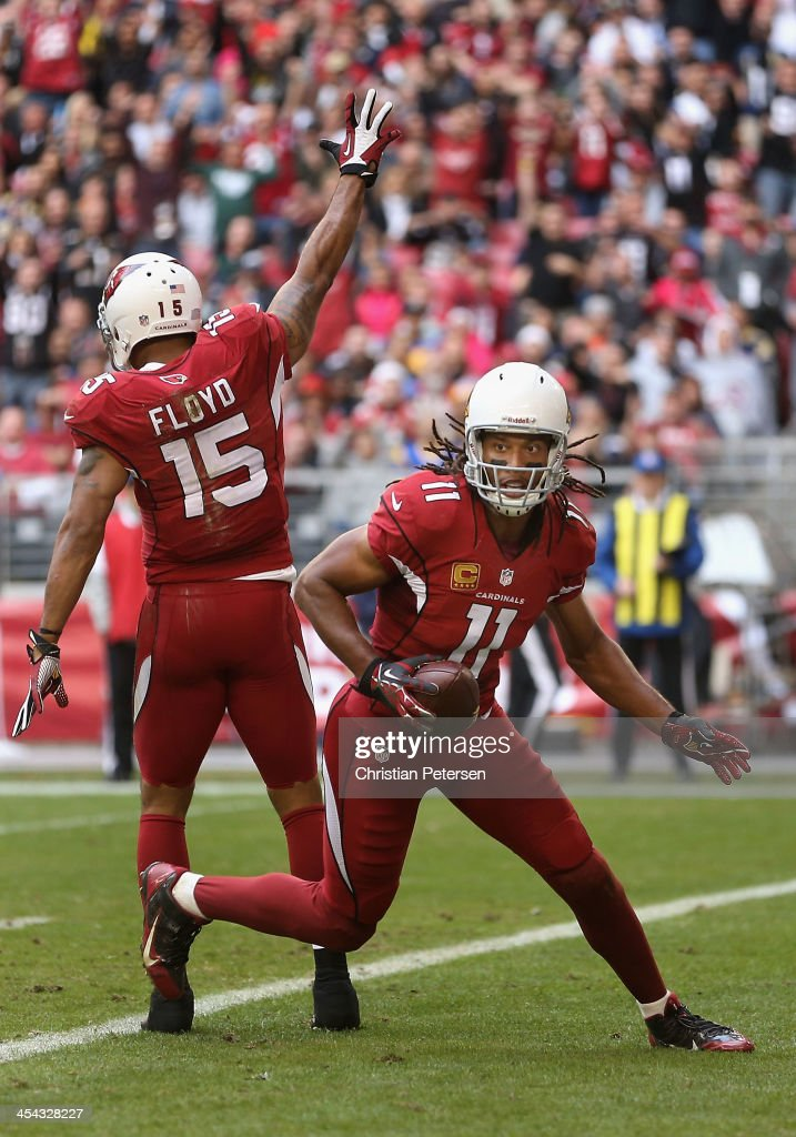 Wide receiver <a gi-track='captionPersonalityLinkClicked' href=/galleries/search?phrase=Larry+Fitzgerald&family=editorial&specificpeople=183380 ng-click='$event.stopPropagation()'>Larry Fitzgerald</a> #11 of the Arizona Cardinals reacts after scoring on a 7 yard touchdown reception against the St. Louis Rams during the second quarter of the NFL game at the University of Phoenix Stadium on December 8, 2013 in Glendale, Arizona.