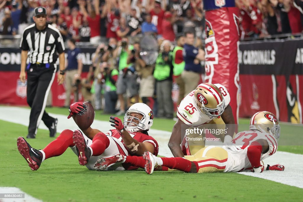 ... Wide receiver Larry Fitzgerald 11 of the Arizona Cardinals reacts after  scoring the game- ... 7cc1f277c