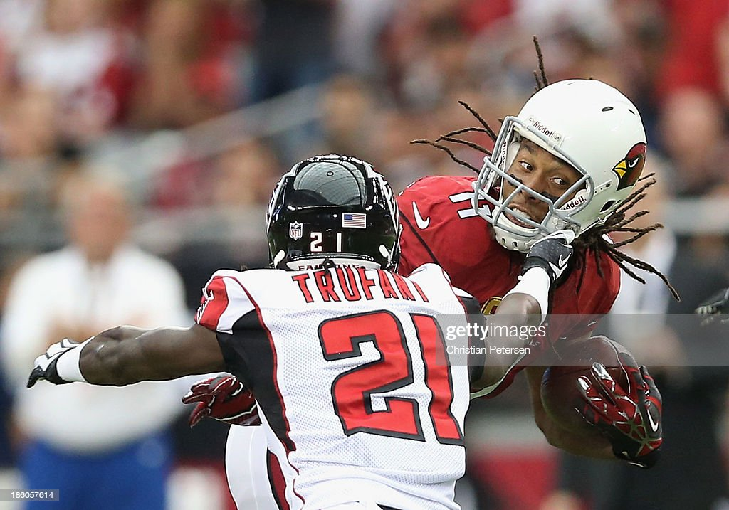Wide receiver <a gi-track='captionPersonalityLinkClicked' href=/galleries/search?phrase=Larry+Fitzgerald&family=editorial&specificpeople=183380 ng-click='$event.stopPropagation()'>Larry Fitzgerald</a> #11 of the Arizona Cardinals runs with the football after a reception past cornerback <a gi-track='captionPersonalityLinkClicked' href=/galleries/search?phrase=Desmond+Trufant&family=editorial&specificpeople=6348548 ng-click='$event.stopPropagation()'>Desmond Trufant</a> #21 of the Atlanta Falcons during the NFL game at the University of Phoenix Stadium on October 27, 2013 in Glendale, Arizona. The Cardinals defeated the Falcons 27-13.
