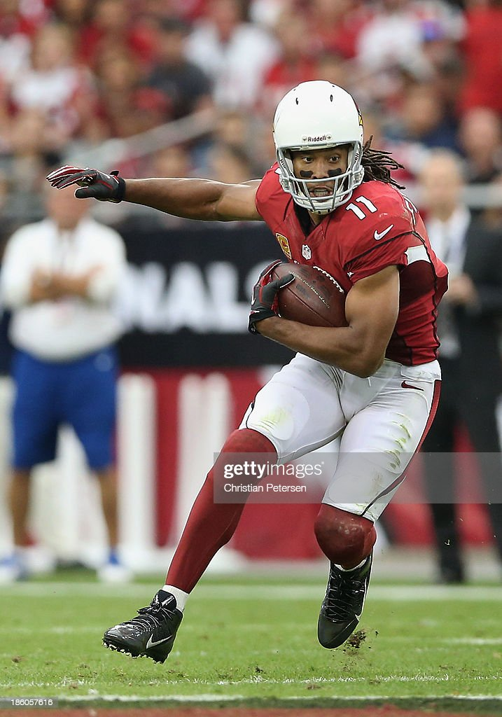 Wide receiver <a gi-track='captionPersonalityLinkClicked' href=/galleries/search?phrase=Larry+Fitzgerald&family=editorial&specificpeople=183380 ng-click='$event.stopPropagation()'>Larry Fitzgerald</a> #11 of the Arizona Cardinals runs with the football after a reception against the Atlanta Falcons during the NFL game at the University of Phoenix Stadium on October 27, 2013 in Glendale, Arizona. The Cardinals defeated the Falcons 27-13.