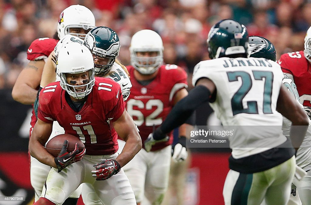 Wide receiver Larry Fitzgerald of the Arizona Cardinals runs with the football after a reception against the Philadelphia Eagles in the second...