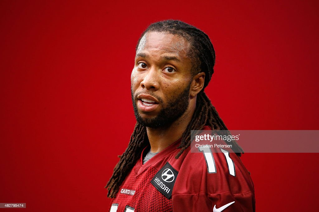 Wide receiver <a gi-track='captionPersonalityLinkClicked' href=/galleries/search?phrase=Larry+Fitzgerald&family=editorial&specificpeople=183380 ng-click='$event.stopPropagation()'>Larry Fitzgerald</a> #11 of the Arizona Cardinals stands on the field during the team training camp at University of Phoenix Stadium on August 2, 2015 in Glendale, Arizona.
