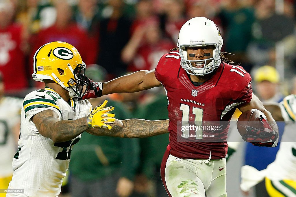 Wide receiver <a gi-track='captionPersonalityLinkClicked' href=/galleries/search?phrase=Larry+Fitzgerald&family=editorial&specificpeople=183380 ng-click='$event.stopPropagation()'>Larry Fitzgerald</a> #11 of the Arizona Cardinals stiff arms strong safety <a gi-track='captionPersonalityLinkClicked' href=/galleries/search?phrase=Morgan+Burnett&family=editorial&specificpeople=4480015 ng-click='$event.stopPropagation()'>Morgan Burnett</a> #42 of the Green Bay Packers during overtime of the NFC Divisional Playoff Game at University of Phoenix Stadium on January 16, 2016 in Glendale, Arizona. The Arizona Cardinals beat the Green Bay Packers 26-20.
