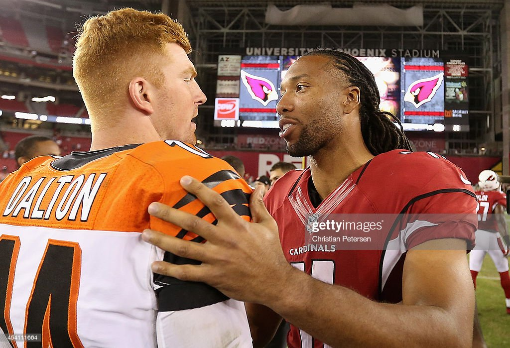 Wide receiver <a gi-track='captionPersonalityLinkClicked' href=/galleries/search?phrase=Larry+Fitzgerald&family=editorial&specificpeople=183380 ng-click='$event.stopPropagation()'>Larry Fitzgerald</a> #11 of the Arizona Cardinals talks with quarterback <a gi-track='captionPersonalityLinkClicked' href=/galleries/search?phrase=Andy+Dalton+-+American+Football+Player&family=editorial&specificpeople=15271549 ng-click='$event.stopPropagation()'>Andy Dalton</a> #14 of the Cincinnati Bengals following the preseason NFL game at the University of Phoenix Stadium on August 24, 2014 in Glendale, Arizona.