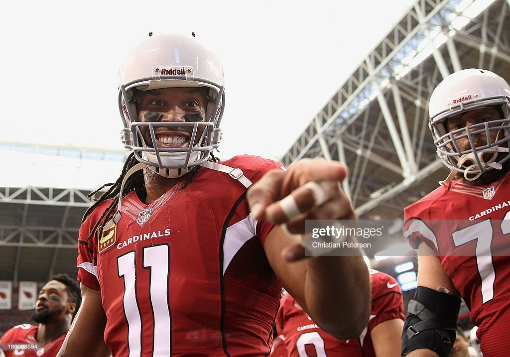 Wide receiver <a gi-track='captionPersonalityLinkClicked' href=/galleries/search?phrase=Larry+Fitzgerald&family=editorial&specificpeople=183380 ng-click='$event.stopPropagation()'>Larry Fitzgerald</a> #11 of the Arizona Cardinals walks off the field before the NFL game against the Atlanta Falcons at the University of Phoenix Stadium on October 27, 2013 in Glendale, Arizona. The Cardinals defeated the Falcons 27-13.