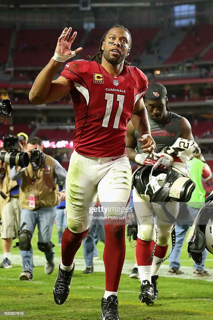 Wide receiver Larry Fitzgerald #11 of the Arizona Cardinals waves to fans as he runs off the field folowing the NFL game against the New Orleans Saints at the University of Phoenix Stadium on December 18, 2016 in Glendale, Arizona. The Saints defeated the Cardinals 48-41.