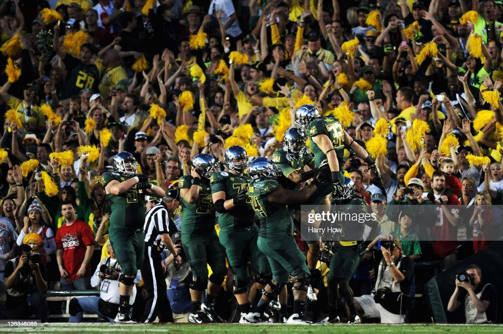 Wide receiver Lavasier Tuinei #80 of the Oregon Ducks celebrates with teammates after an 11-yard touchdown in the fourth quarter against the Wisconsin Badgers at the 98th Rose Bowl Game on January 2, 2012 in Pasadena, California.