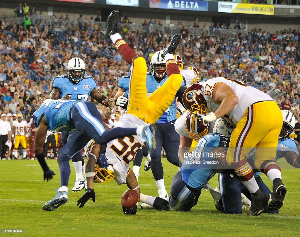 Wide receiver Leonard Hankerson #85 of the Washington Redskins dives into the end zone to score a touchdown against the Tennessee Titans during a pre-season game at LP Field on August 8, 2013 in Nashville, Tennessee.
