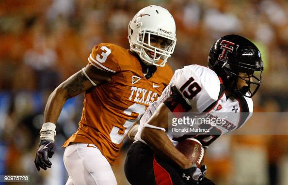Wide receiver Lyle Leong of the Texas Tech Red Raiders runs the ball past Curtis Brown of the Texas Longhorns at Darrell K RoyalTexas Memorial...