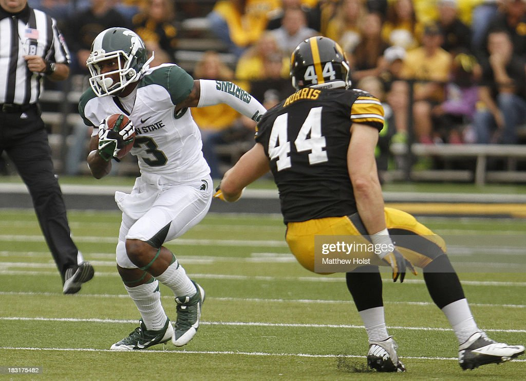 Wide receiver Macgarrett Kings Jr. #3 of the Michigan State Spartans rushes up field during the first quarter past linebacker James Morris #44 of the Iowa Hawkeyes on October 5, 2013 at Kinnick Stadium in Iowa City, Iowa. Michigan State won 26-14.