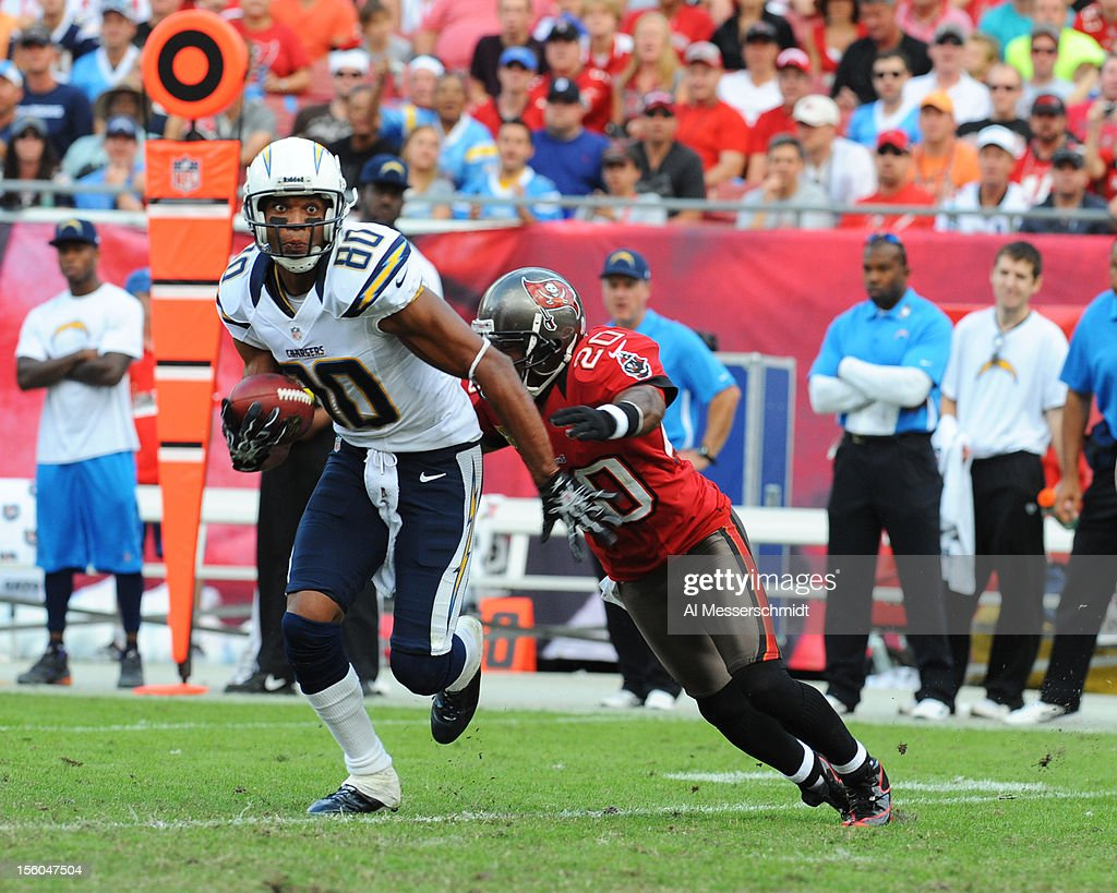 Wide receiver Malcolm Floyd #80 of the San Diego Chargers grabs a midfield pass against the Tampa Bay Buccaneers November 11, 2012 at Raymond James Stadium in Tampa, Florida. Tampa won 34 - 24.