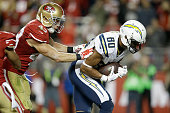 Wide receiver Malcom Floyd of the San Diego Chargers catches an 11yard touchdown in the fourth quarter against strong safety Craig Dahl of the San...