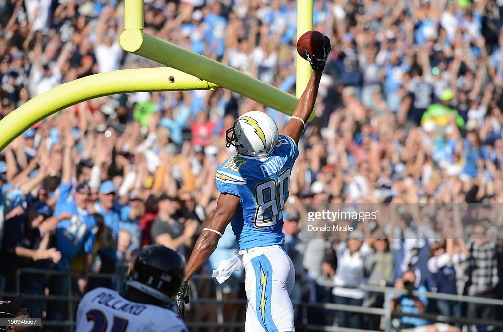 Wide Receiver Malcom Floyd #80 of the San Diego Chargers dunks the ball in the field goal uprights after scoring a touchdown against Baltimore Ravens on November 25, 2012 at Qualcomm Stadium in San Diego, California.