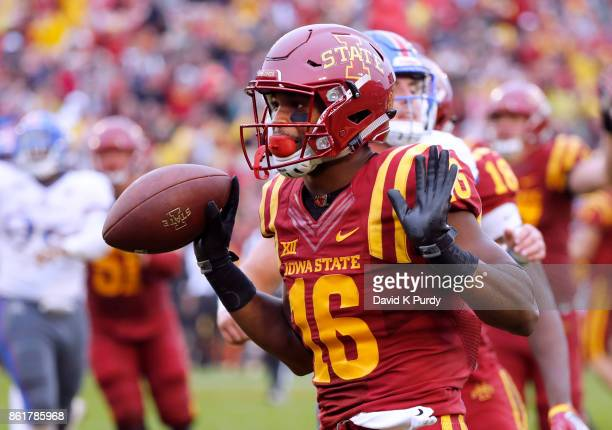 Wide receiver Marchie Murdock of the Iowa State Cyclones celebrates scoring a touchdown in the second half of play against the Kansas Jayhawks at...