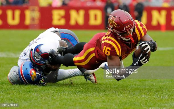 Wide receiver Marchie Murdock of the Iowa State Cyclones is tackled by cornerback Kyle Mayberry of the Kansas Jayhawks the first half of play at Jack...