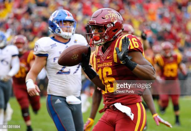 Wide receiver Marchie Murdock of the Iowa State Cyclones runs into the end zone for a touchdown as cornerback DeAnte Ford of the Kansas Jayhawks...
