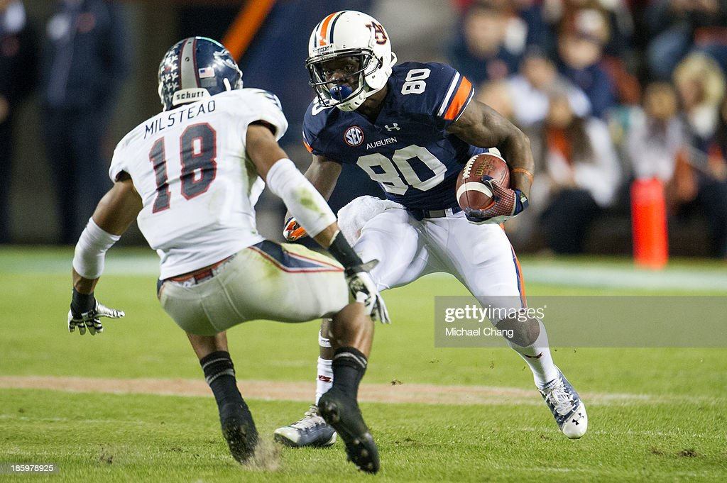 Wide receiver Marcus Davis #80 of the Auburn Tigers looks to maneuver by defensive back Christian Milstead #18 of the Florida Atlantic Owls during the second half of play on October 26, 2013 at Jordan-Hare Stadium in Auburn, Alabama. Auburn defeated Florida Atlantic 45-10.