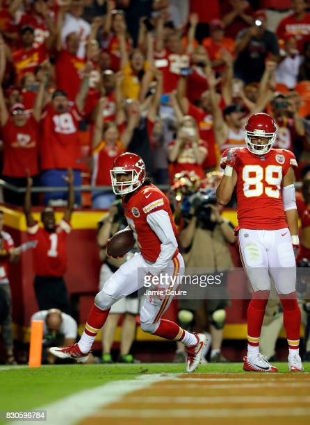 Wide receiver Marcus Kemp of the Kansas City Chiefs catches a pass for a touchdown during the preseason game against the San Francisco 49ers at...