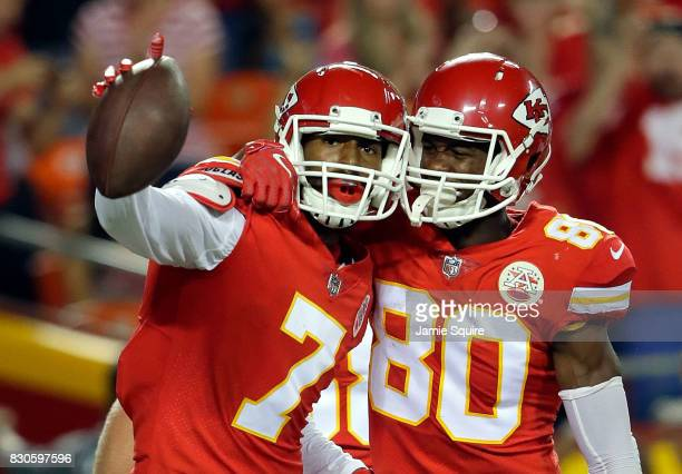 Wide receiver Marcus Kemp of the Kansas City Chiefs celebrates with wide receiver Jehu Chesson after making a catch for a touchdown during the...