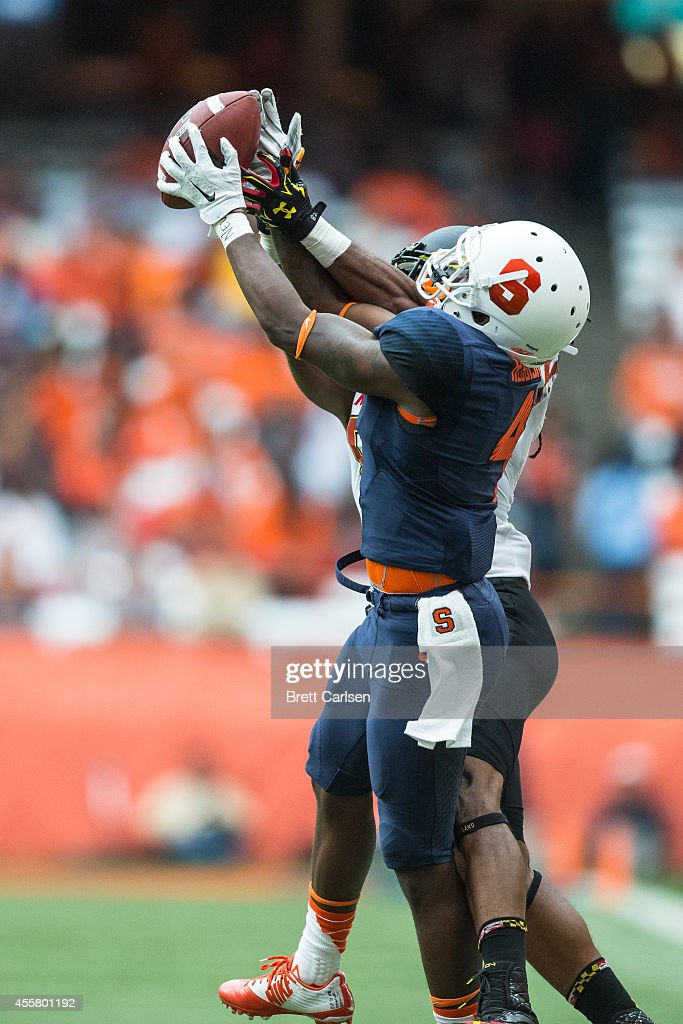 Wide receiver Marcus Leak #82 of the Maryland Terrapins pulls in a big first down reception while cornerback Brandon Reddish #4 of the Syracuse Orange defends during the second quarter on September 20, 2014 at The Carrier Dome in Syracuse, New York. Maryland defeats Syracuse 34-20.