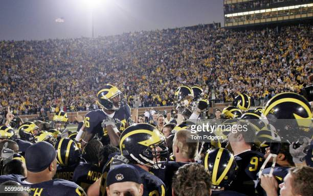 Wide receiver Mario Manningham of the Michigan Wolverines celebrates with teammates after scoring the game winning touchdown against the Penn State...