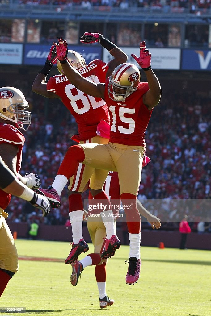Wide receiver Mario Manningham #82 of the San Francisco 49ers celebrates with wide receiver Michael Crabtree #15 after scoring a touchdown against the Buffalo Bills during the third quarter at Candlestick Park on October 7, 2012 in San Francisco, California. The San Francisco 49ers defeated the Buffalo Bills 45-3. Photo by Jason O. Watson/Getty Images)