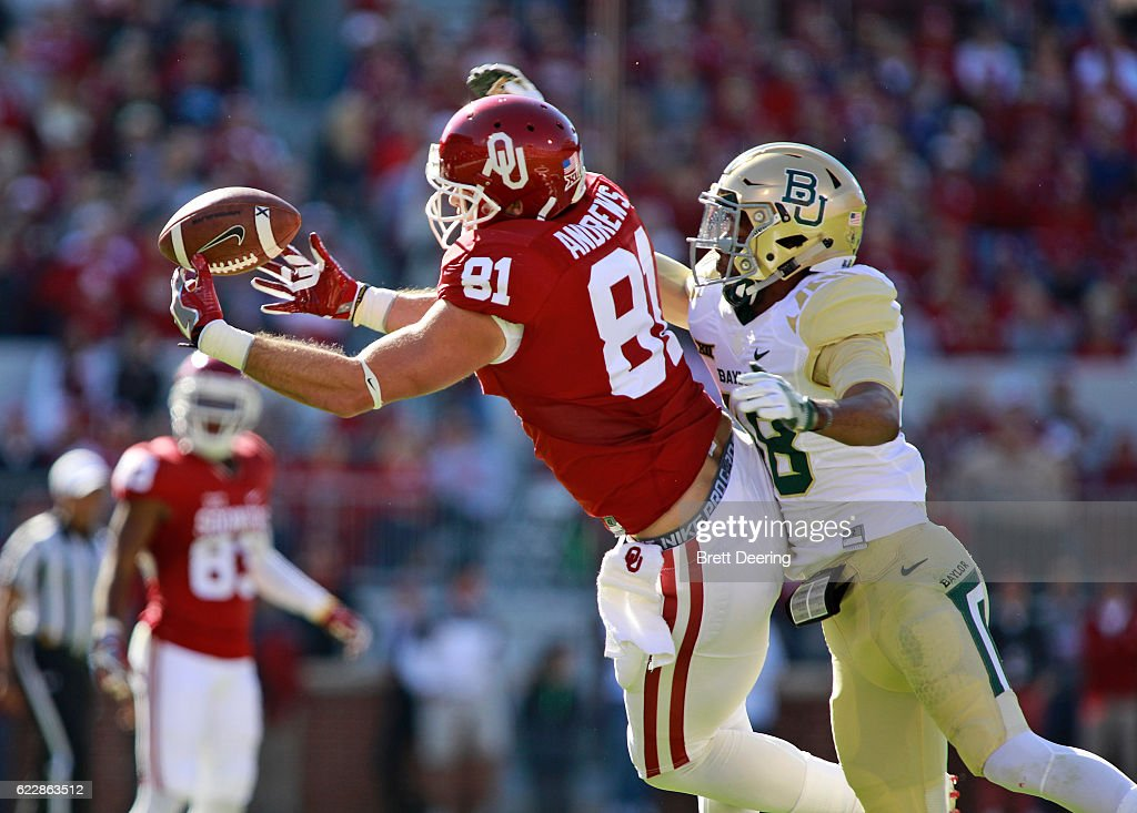 Wide receiver Mark Andrews #81 of the Oklahoma Sooners makes a catch as defensive back Travon Blanchard #48 of the Baylor Bears defends November 12, 2016 at Gaylord Family-Oklahoma Memorial Stadium in Norman, Oklahoma. Oklahoma defeated Baylor 45-24.