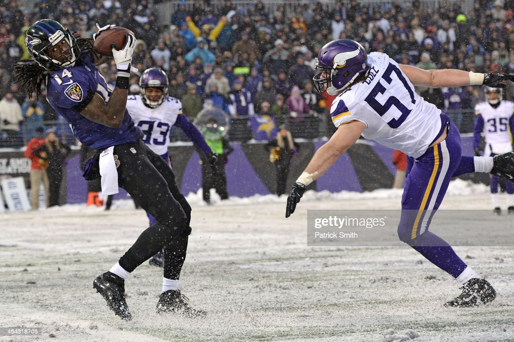 Wide receiver Marlon Brown #14 of the Baltimore Ravens catches the game-winning touchdown against the Minnesota Vikings in the fourth quarter at M&T Bank Stadium on December 8, 2013 in Baltimore, Maryland. The Baltimore Ravens won, 29-26.