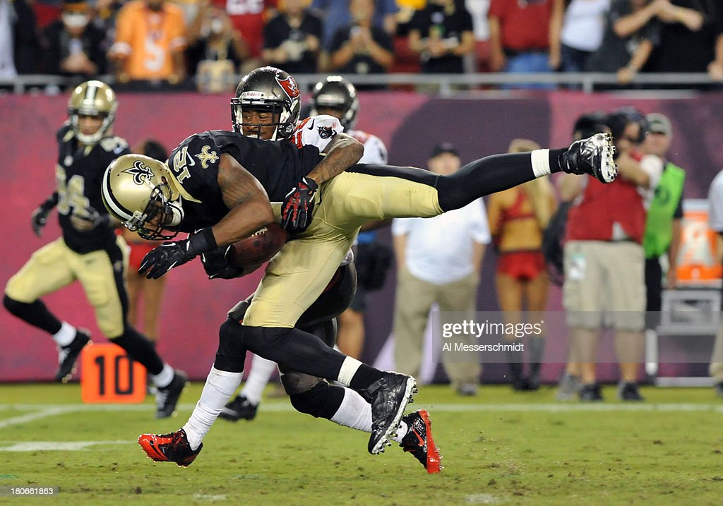 Wide receiver <a gi-track='captionPersonalityLinkClicked' href=/galleries/search?phrase=Marques+Colston&family=editorial&specificpeople=741430 ng-click='$event.stopPropagation()'>Marques Colston</a> #12 of the New Orleans Saints grabs a 4th-quarter pass on the game-winning drive against the Tampa Bay Buccaneers September 15, 2013 at Raymond James Stadium in Tampa, Florida. The Saints won 16 - 14.