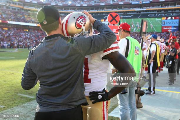 Wide receiver Marquise Goodwin of the San Francisco 49ers is consoled by a coach as time expires and the San Francisco 49ers lose to the Washington...