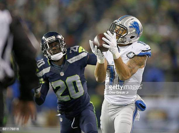 Wide receiver Marvin Jones of the Detroit Lions brings in a catch against the Seattle Seahawks in the NFC Wild Card game at CenturyLink Field on...
