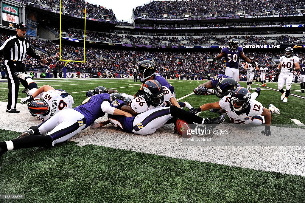 Wide receiver Matt Willis #12 of the Denver Broncos battles for a fumbled Denver Broncos ball against the Baltimore Ravens at M&T Bank Stadium on December 16, 2012 in Baltimore, Maryland. The Denver Broncos won, 34-17.