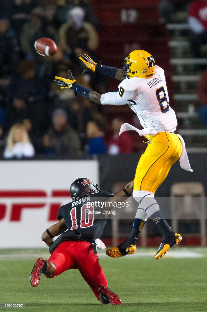 Wide receiver Matthew Hurdle #8 of the Kent State Golden Flashes leaps to catch a pass over defensive back Artez Brown #10 of the Arkansas State Red Wolves on January 6, 2013 at Ladd-Peebles Stadium in Mobile, Alabama. Arkansas State defeated Kent State 17-13.
