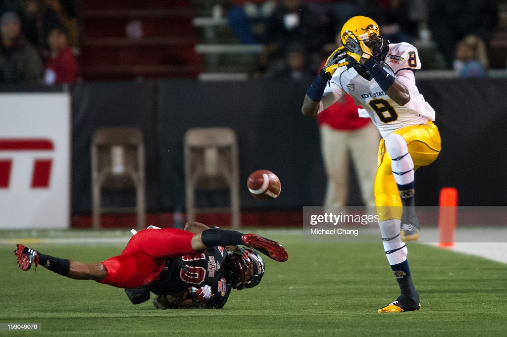 Wide receiver Matthew Hurdle #8 of the Kent State Golden Flashes reacts after missing a pass over defensive back Artez Brown #10 of the Arkansas State Red Wolves on January 6, 2013 at Ladd-Peebles Stadium in Mobile, Alabama. At halftime Arkansas State leads Kent State 14-10.