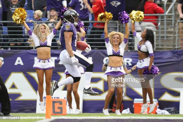 Wide Receiver Michael Campanaro of the Baltimore Ravens celebrates after returning a punt for a touchdown in the fourth quarter against the Chicago...