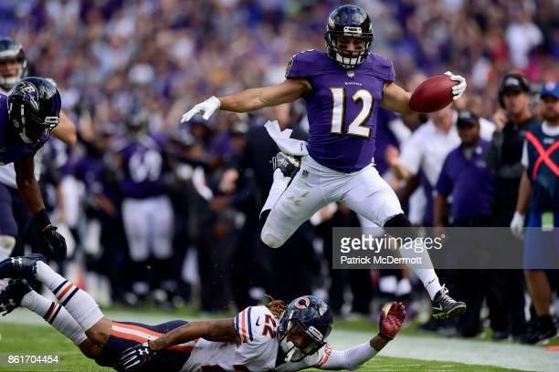 Wide Receiver Michael Campanaro of the Baltimore Ravens returns a punt for a touchdown in the fourth quarter against the Chicago Bears at MT Bank...